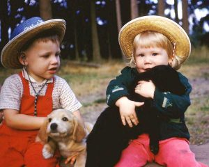 girland boy with dogs